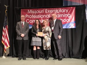 Dogwood Elementary staff members accept Exemplary PLC School award at Powerful Learning Conference