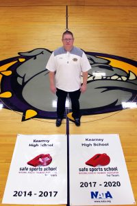 Athletic Trainer, Owen Iseminger with Safe Sport Distinction Award Banners